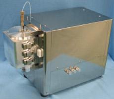 金属ナノ粒子連続合成装置の照射部の写真